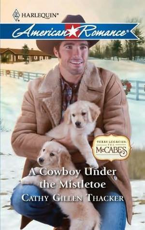 A Cowboy Under the Mistletoe (Texas Legacies: The McCabes #2)