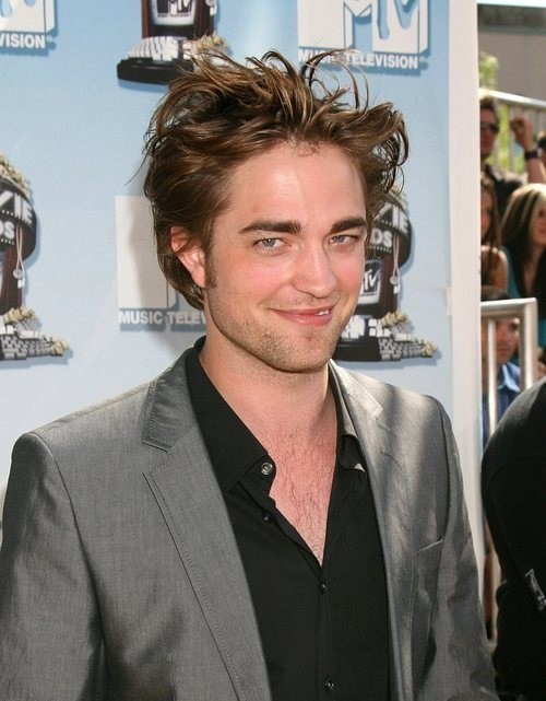 This is just Robert Pattinson at a premiere. Not him as Edward. Still hot as ever!