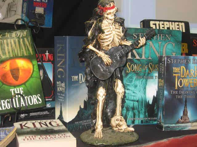 The reason the skeleton playing the guitar is there, signifies Stephen King's band, The Rock Bottom Remainders, a band of famous authors!