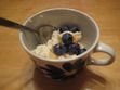 "To quote Alana, ""I am a cheese maker!"" Here's a photo of my ricotta, topped with fresh blueberries, honey, and a touch of cinnamon. I served it to my partner and another friend for dessert last night. Hooray!"