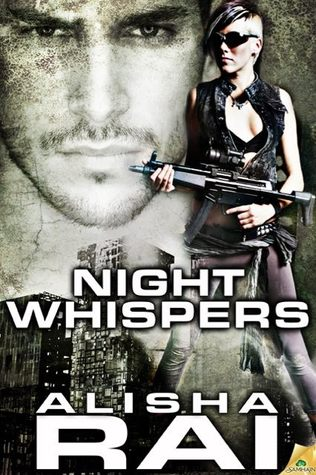 Title: Night Whispers. Author: Alisha Rai. To the left there's a face of a man. To the right a woman wearing sunglasses is standing and holding a rifle.  Their pictures is blended with a skyline of a ruined city at the bottom.