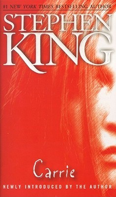 A half of a girl's face is visible on the right side of the cover. Everything is seen through a blood red hue. Author: Stephen King, Title: Carrie. Below the title reads: Newly introduced by the author.