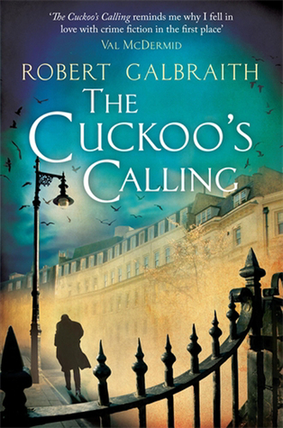Author: Robert Galbraith (pseudonym of J.K. Rowling's). Title The Cuckoo's Calling. Over an iron railing can be seen a brightly lit, slanted street with white stone buildings four or five stories high. There's a silhouette of man walking against the wind and away from the viewer.